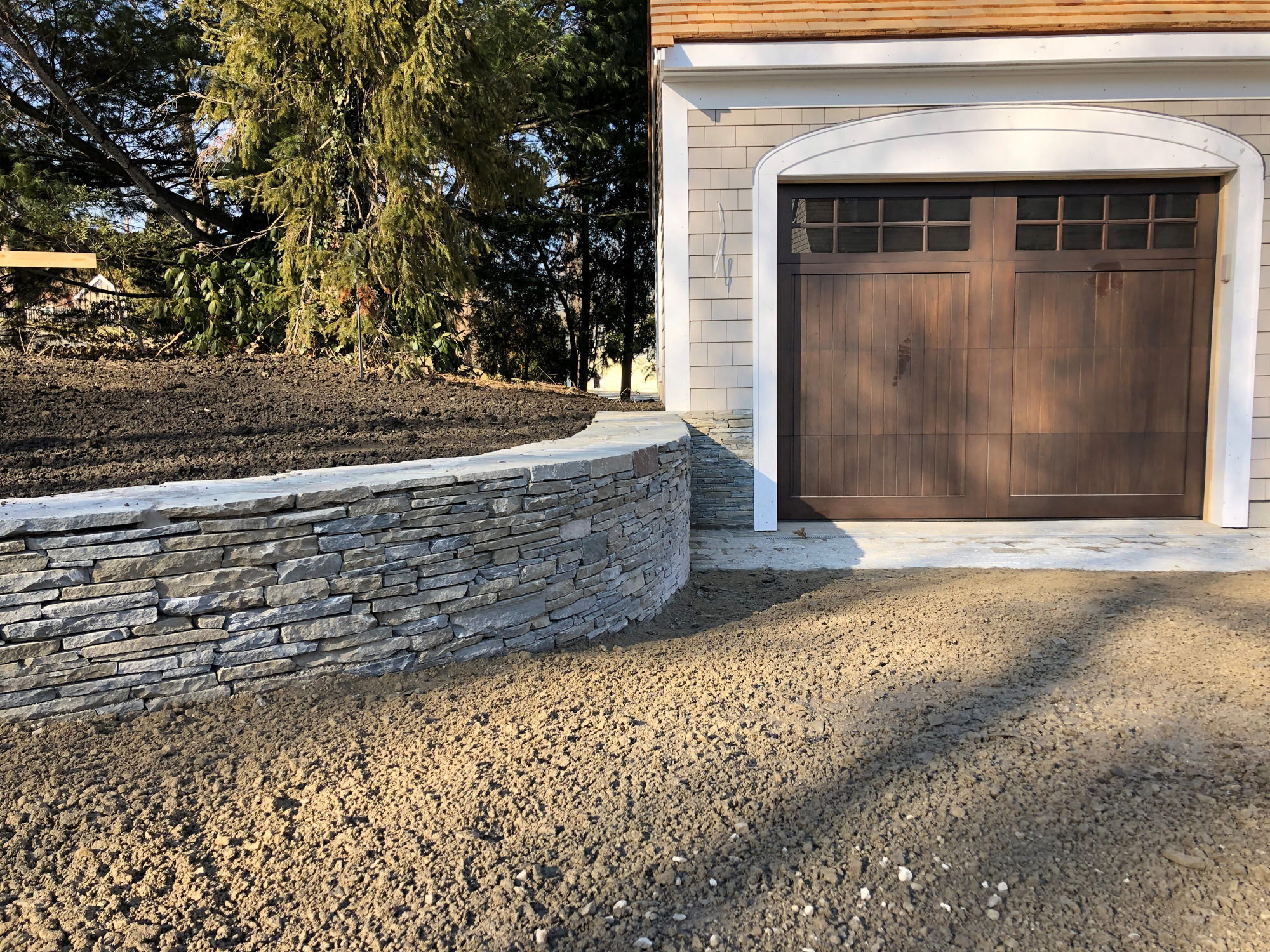 stone wall next to garage